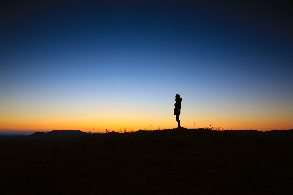 Man Standing Alone at Sunset